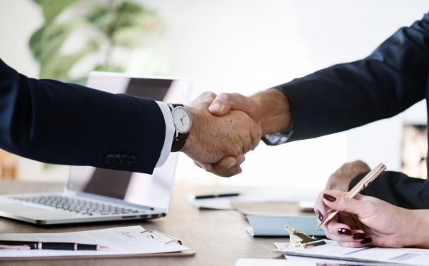 People shaking hands after a deal or new job